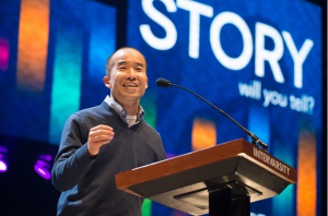 (Photo courtesy InterVarsity Christian Fellowship) InterVarsity President Tom Lin speaks at Urbana 2015.