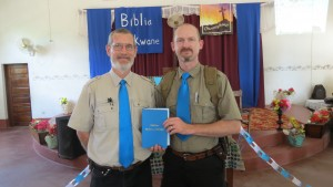 MAF staff, Dave LePoidevin and Dave Holmes, holding a copy of the Takwane Bible. (Caption and Photo courtesy of MAF)