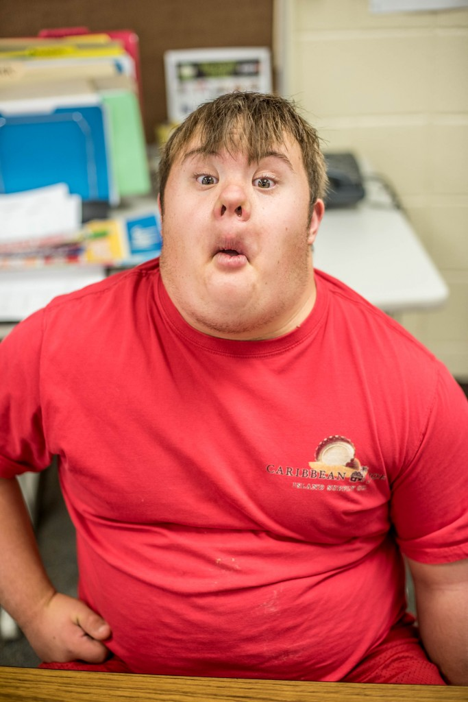 Andrew, a student Lincoln Schools, makes a silly face for his picture.