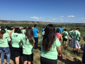The On Eagles' Wings team praying over the mission field. (Photo courtesy of Ron Hutchcraft Ministries via Facebook)