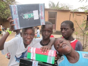 (Photo Courtesy Norm Copeland via Flickr) Boys show off their Operation Christmas Child shoe boxes just before opening them.