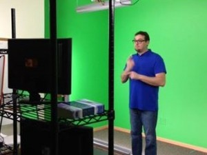 A member of DOOR's ASL translation team signs on-camera. (Photo, caption courtesy DOOR)