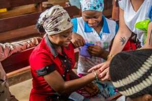 Open Doors workers brining hope to the persecuted Church through Psalm 23 bracelets (Photo courtesy of Open Doors USA)