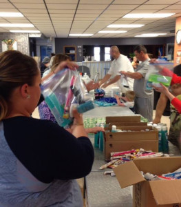Packing relief aid for the Middle East (Photo courtesy of Vision Beyond Borders).