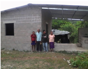 The work in Choluteca includes helping the impoverished rebuild better houses (Photo courtesy of Overholts).