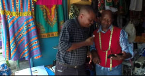 Deaf Bible Society's Africa Coordinator, Simon, and a Kenyan man watch the Deaf Bible in Kenyan Sign Language. (Screen capture courtesy of Deaf Bible Society)