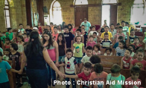 Children's programs in Aleppo have led to a steep increase in people coming to Christ since war broke out in 2011. (Caption, photo courtesy of Christian Aid Mission)