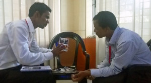 (Photo Courtesy FMI for MNN use.) A pastor and a church member role-playing during the conference in Bangladesh to practice using their Snapshot packets.