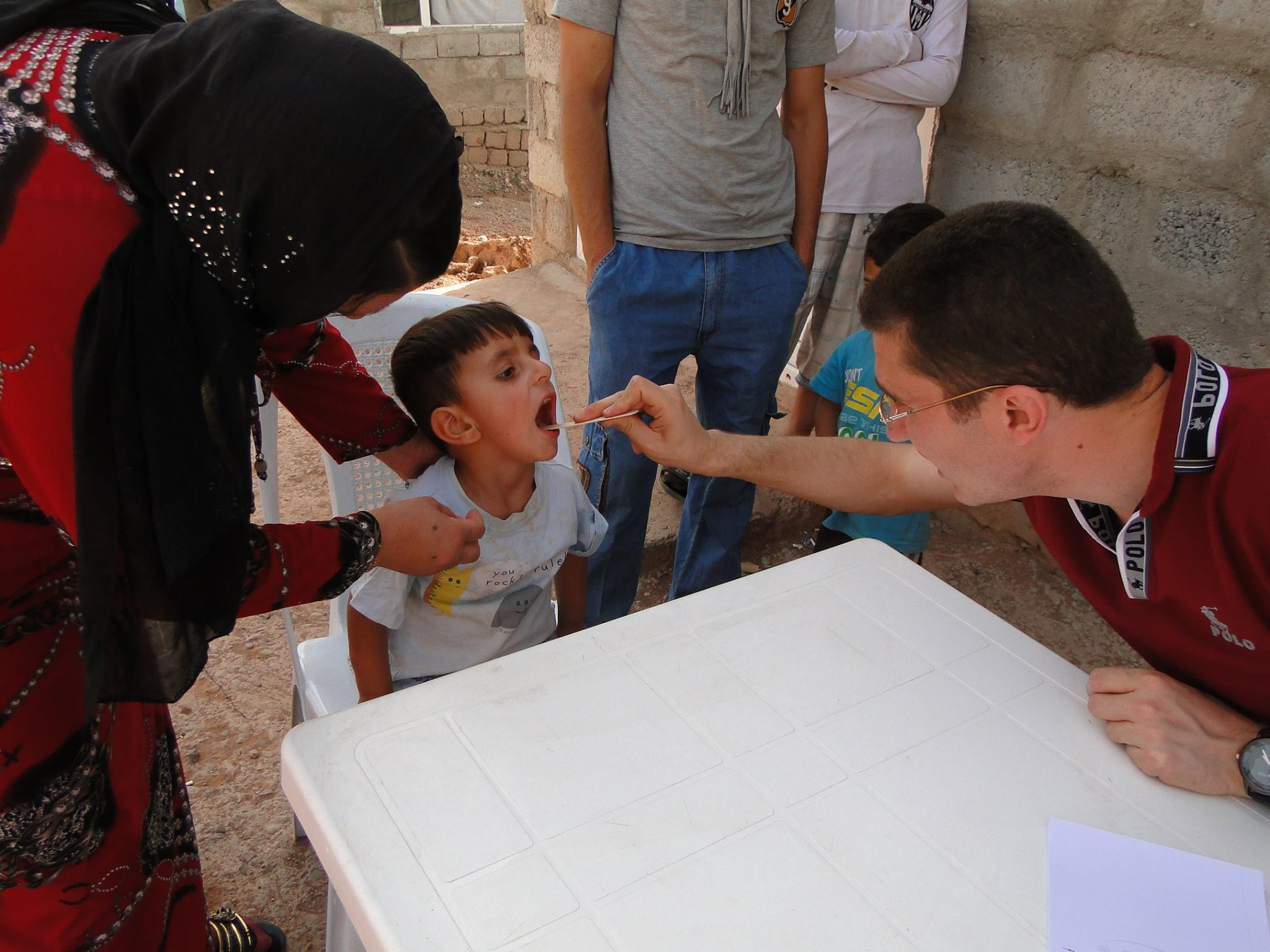 Iraqi refugees aided by Christian medical clinic on wheels