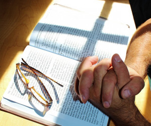 hands-folded-bible-glasses-prayer-cross-window-pixabay