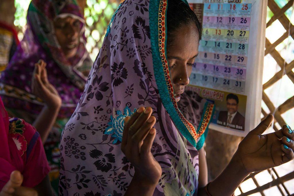Indian woman, praying, prayer, worship, praise, singing, raised hands