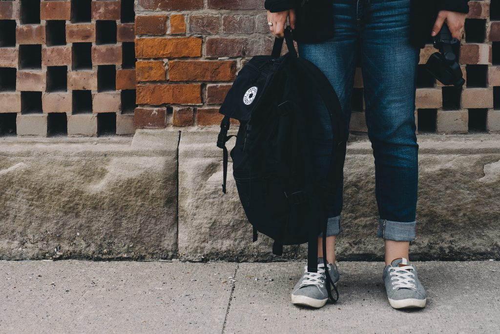 backpack, student, brick wall, unsplash