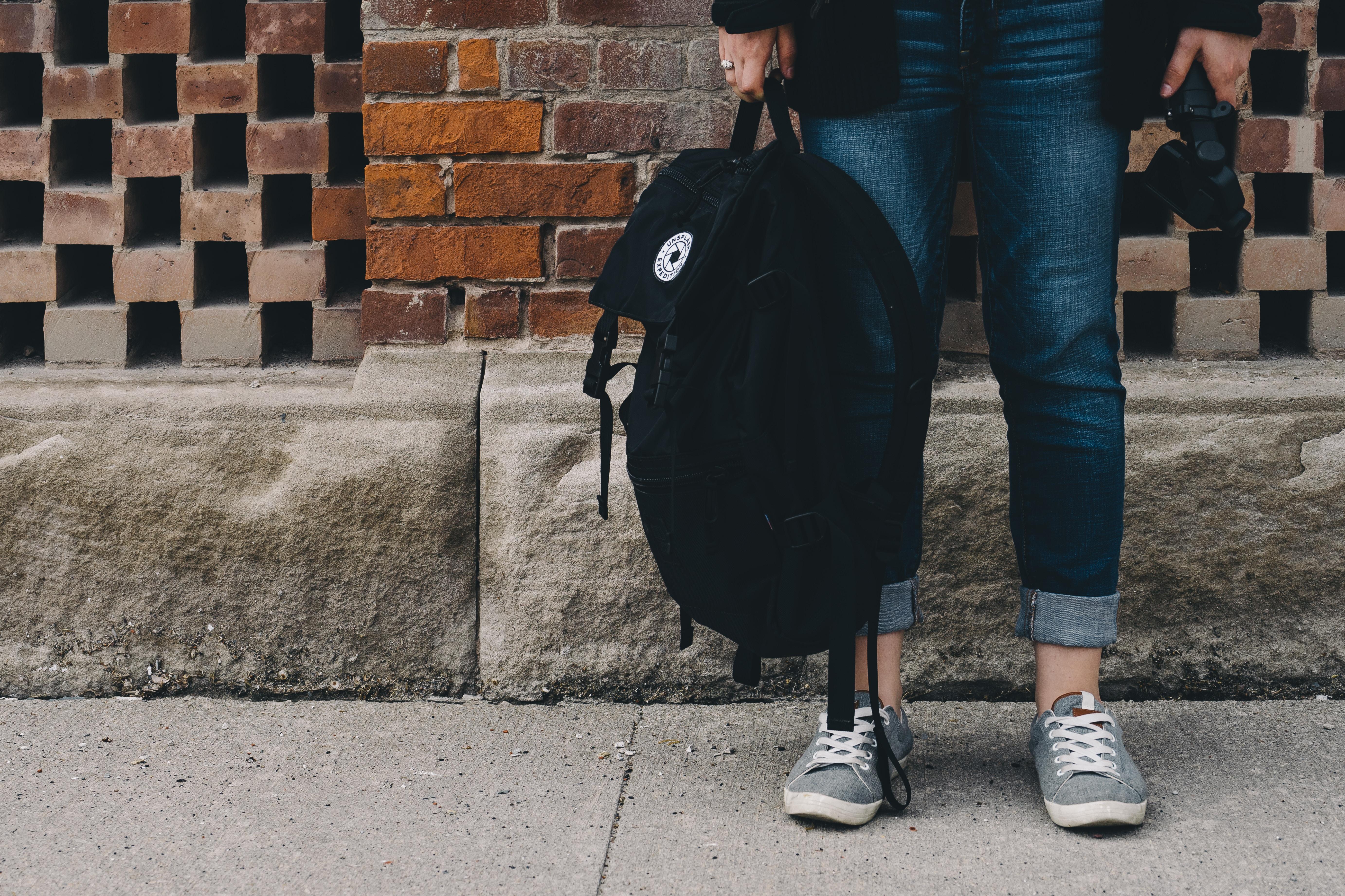 backpack, student, brick wall, unsplash