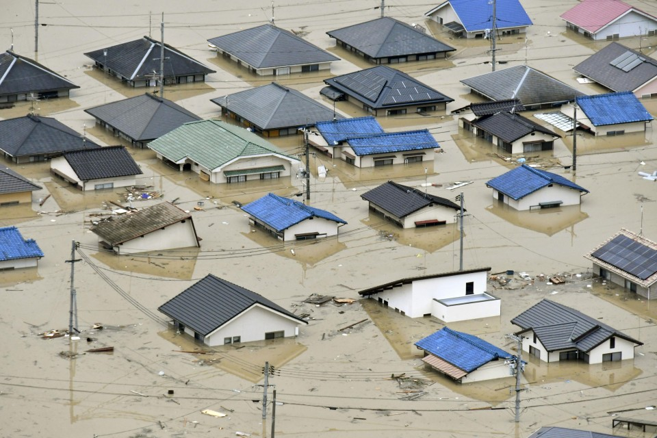 Record rainfall submerges Japan