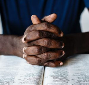 black praying hands, prayer, bible