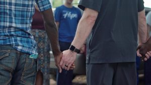 holding hands, praying