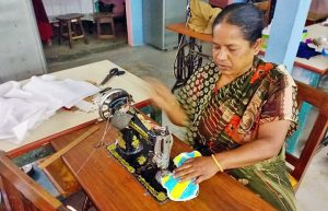Bangladeshi woman making face masks in COVID-19 Pandemic