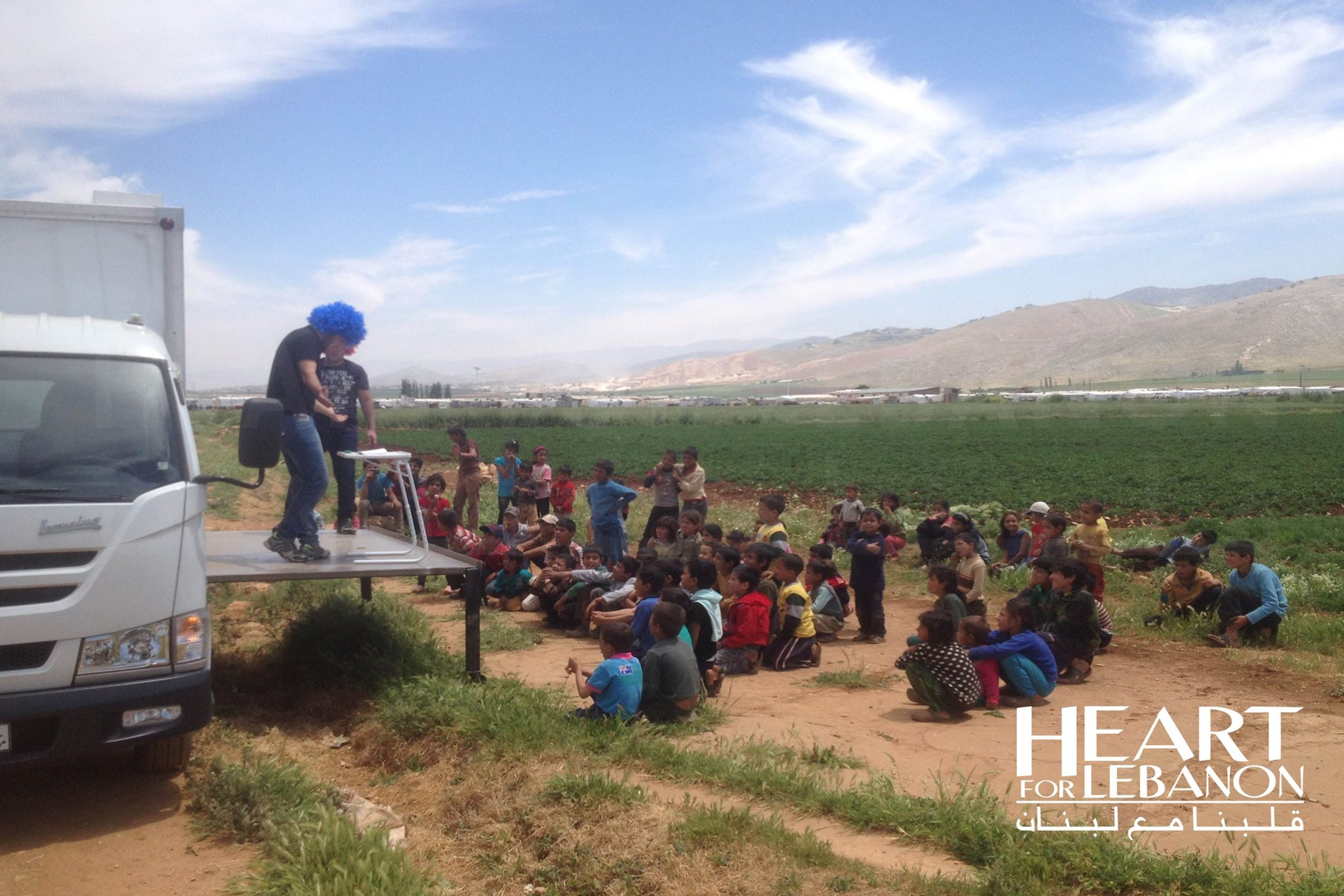 Summer camp in refugee camps? Yes, and it's out of a truck.