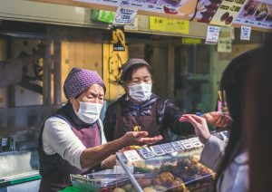 Women shopkeepers in Japan during COVID - photo courtesy of Jeremy Stenuit via Unsplash