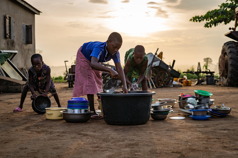 children washing dishes, kids, africa