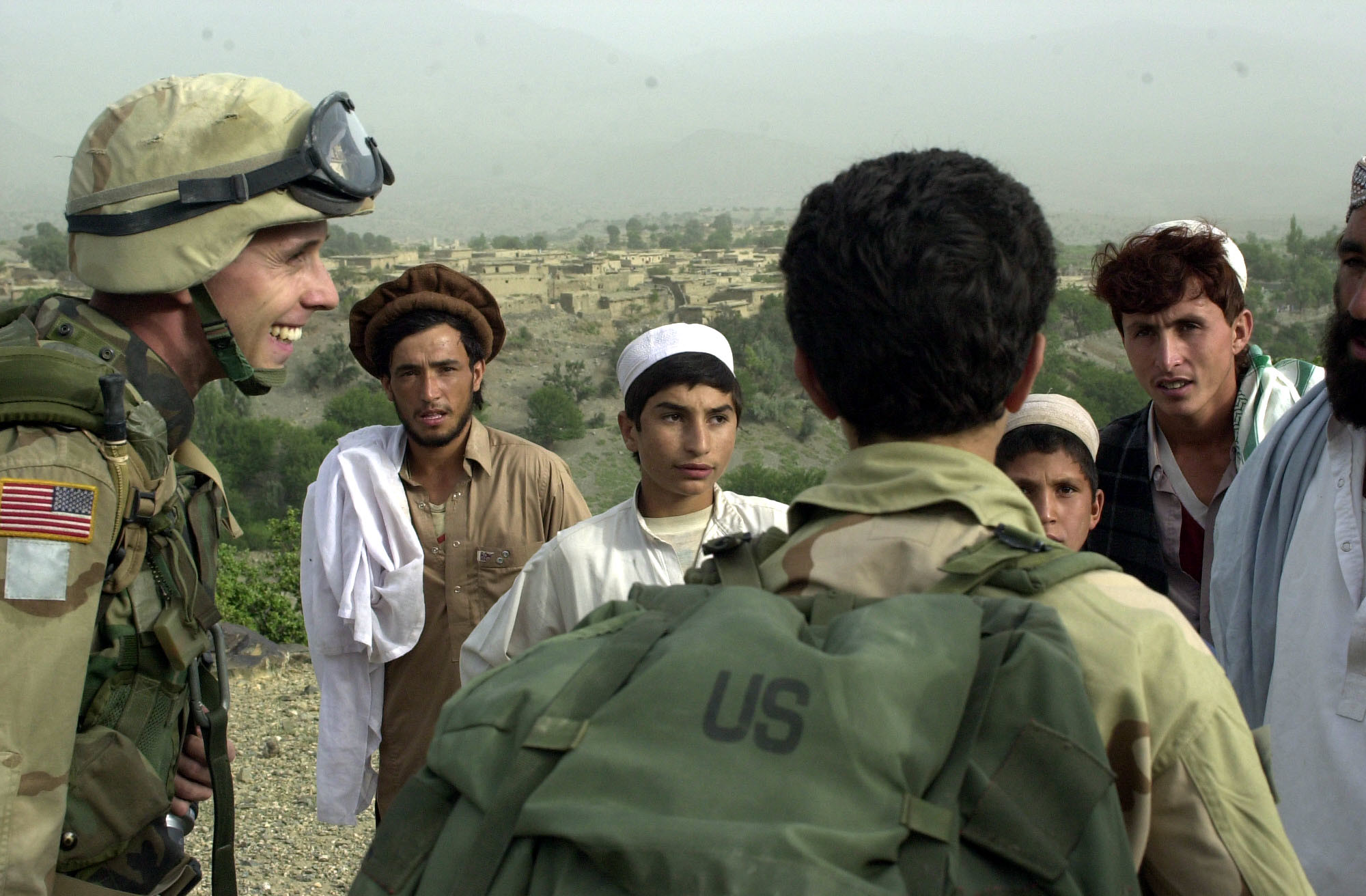 Foreign forces leave Afghanistan, government arms citizens
