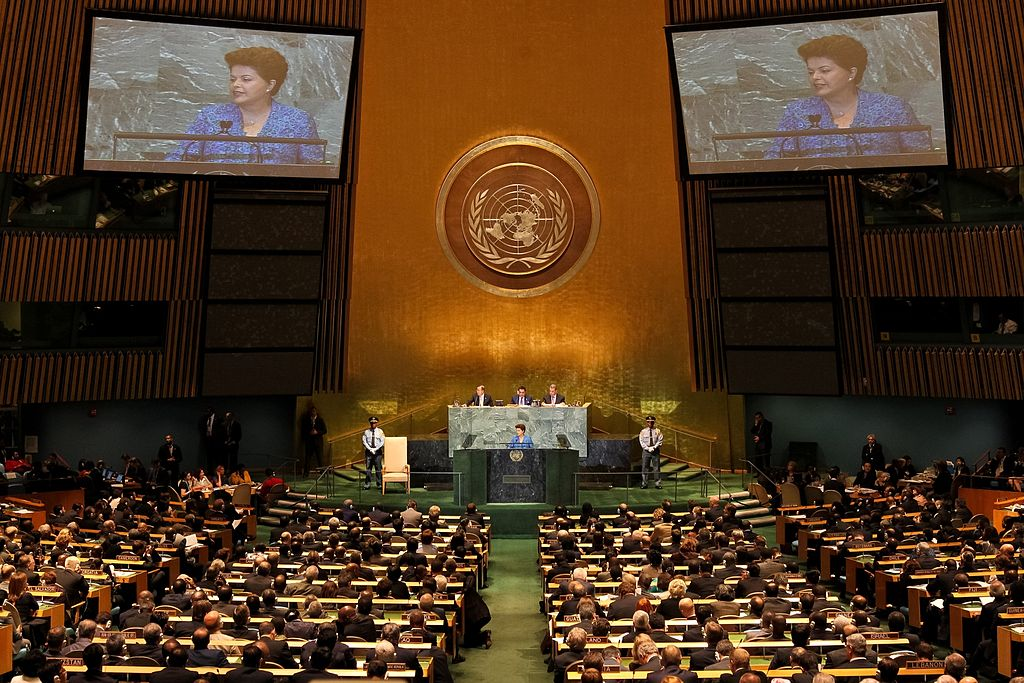 The header photo shows the United Nations General Assembly. (Photo courtesy of Roberto Stuckert Filho/PR, CC BY-SA 2.5 <https://creativecommons.org/licenses/by-sa/2.5>, via Wikimedia Commons)